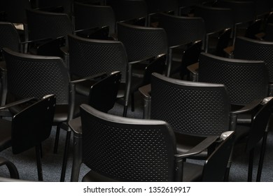 Objects. Classroom with black chairs profiled.