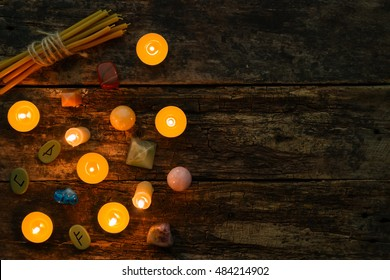 objects for divination, runes and candle on a wooden background mockup