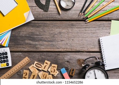 Objects for education, school supplies, office on a wooden background