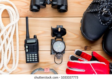objects for extreme mountain climbing winter view from above on a wooden background