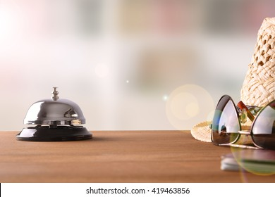 Objects of a tourist on the table in a hotel reception. Concept hotel, travel, room. Front view