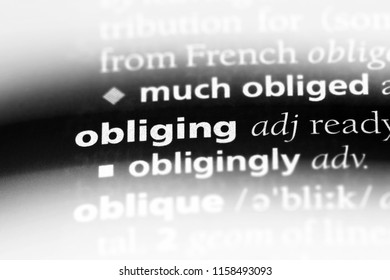 obliging word in a dictionary. obliging concept.