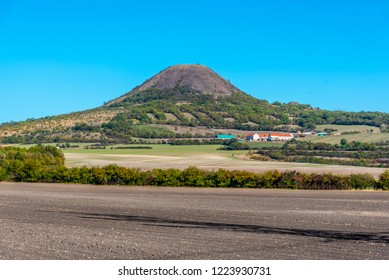 Oblik hill in the middle of Ceske Stredohori, aka Central Bohemian Highlands. Landscape with typical spiky hills of volcanic origin, Czech Republic.