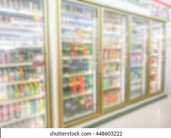 Oblique and blurred row of cold fridge in the mini mart which fully store many kind of drink.