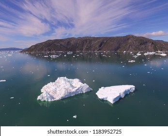 Oblique drone image of melting icebergs in a fjord in Greenland