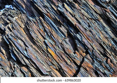 The oblique texture of colorful layered stone of Shale from Caucasus