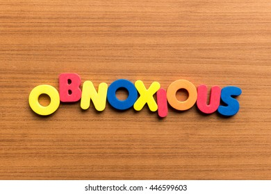 obnoxious colorful word on the wooden background