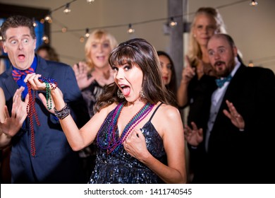 Obnoxious woman with beads prepares to flash her breast at a party