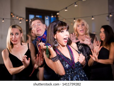Obnoxious woman prepares to flash her breast at a party