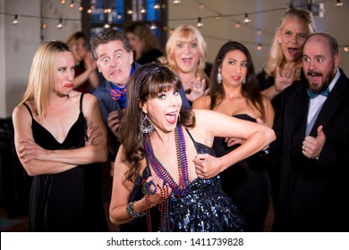 Obnoxious woman prepares to flash her breasts at a party crowd