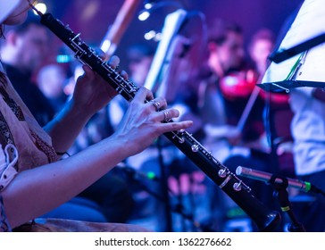 Oboe. Female hands with oboe during a live performance