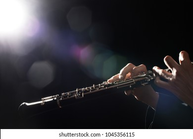 Oboe player hands. Woodwind classical musical instruments closeup