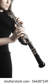 Oboe player oboist playing music instrument isolated on white background. Musician hands with instruments close up