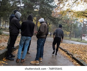 Obrenovac, Belgrade, Serbia 11/15/17. A group of asylum seekers talk outside the dining hall area in Obrenovac refugee camp.