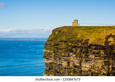 O'Brien's tower built on rugged cliffs facing a vast ocean seascape. Cliffs of Moher, Ireland's most spectacular natural wonder at the heart of the Wild Atlantic Way, County Clare.