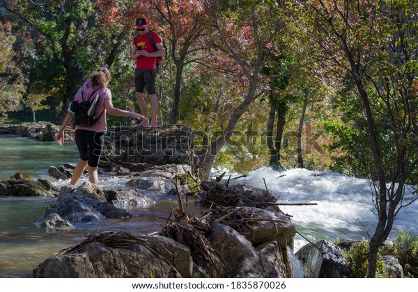 Obrovac, Croatia - 10/18/2020, Two people crossing the Kuda's bridge over the Krupa river, Croatia