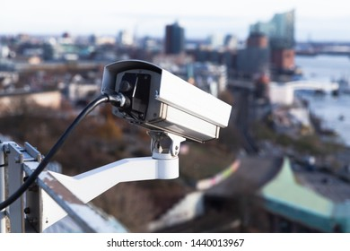 Observation closed-circuit television camera mounted on a rooftop of a port building in Hamburg harbor, Germany