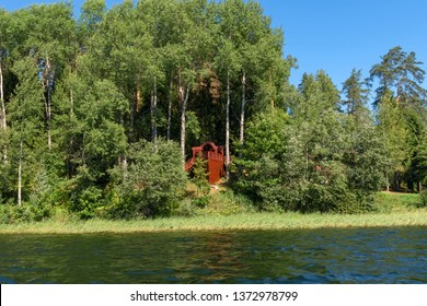 Observation deck in the form of a ship in the forest on the shore of a forest lake