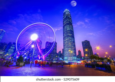 Observation Ferris Wheel in Hong Kong City and Full Moon Night Light