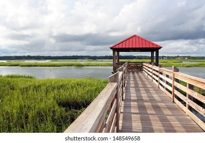 Observation and fishing pier in marshland at Hilton Head Island, South Carolina, USA. Hilton Head Island is a popular beach resort and vacation destination on the east coast of the United States.