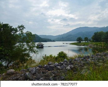 Observation site of Lake Bang Wad on Phuket Island in the afternoon, Thailand. Landscape with a cloudy sky and karstic mountains in the background. Southeast Asia.