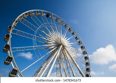 Observation wheel in Gdansk in Poland. Observation wheel against the blue sky with white clouds.