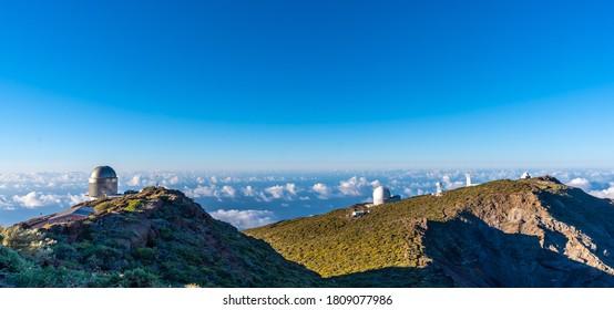 Observatories of the Roque de los Muchachos in the Caldera de Taburiente with a sea of nuts below one summer afternoon, La Palma, Canary Islands. Spain