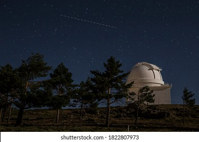 observatory astronomical dome in night sky