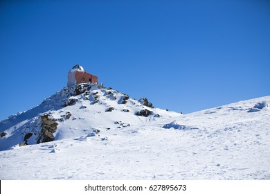 Observatory in a mountain snow.