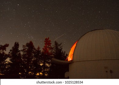 Observatory on Mt Lemmon in Tucson AZ at night with stars.