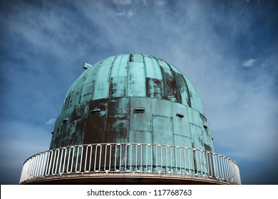 observatory for the science of astronomy at herstmonceux in england. Dome building for star telescope against blue sky