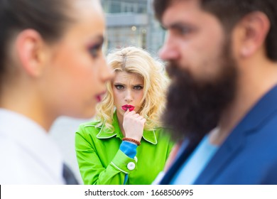 Obsessed ex girlfriend spying to a couple dating. She is obviously jealous. Bearded man cheating his girlfriend with another woman. Unhappy girl feeling jealous