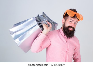 Obsessed with shopping. Addicted consumer concept. Man carefree bearded hold shopping bags. Shopping dumb wasting money. Stupid things you do with your money. How to stop buying things you dont need.
