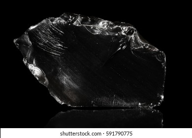 Obsidian, volcanic glass, black background, natural rock, reflections