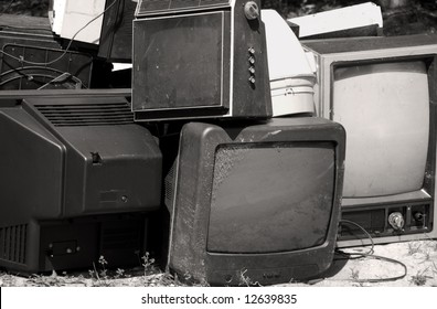 Obsolete or broken television stacked for disposal