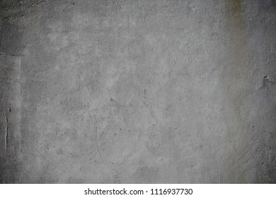 Obsolete concrete wall as a grunge background.