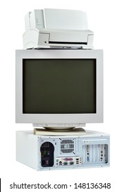 Obsolete PC commuter, printer and CRT monitor. Stack of old, used computer, monitor and printer, electronic waste isolated on white background.