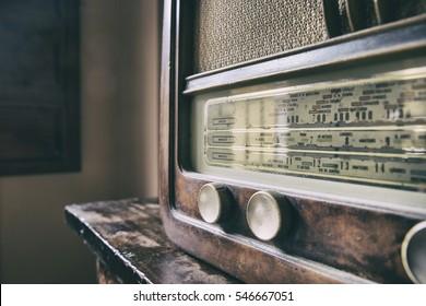 Obsolete radio in wooden case. Horizontal indoors shot