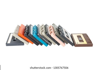 Obsolete technology of audio recording and playback format audio cassette tape isolated on white background with clipping path. Cassette tapes stack leaning in horizontal line .