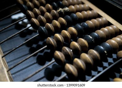 Obsolete wooden abacus, black background