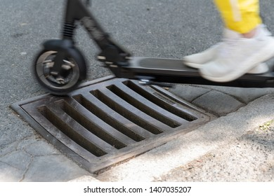 Obstacles in the city - e-scooter rolls over sewer grid