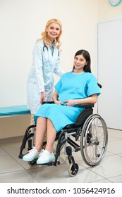 obstetrician gynecologist and pregnant woman on wheelchair at maternity hospital