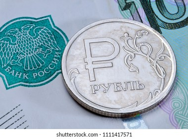 Obverse of coin one Russian ruble with symbol of Russian currency on a banknote 1000 roubles