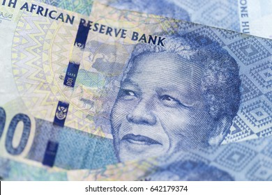 Obverse of South African ZAR banknote with a denomination of 100 rand, and an image of Nelson Mandela.
