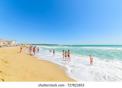 OBZOR, BULGARIA - JUL 14, 2017: City Beach. Children are waiting for the sea waves on the beach. Picture taken during a trip to Bulgaria.