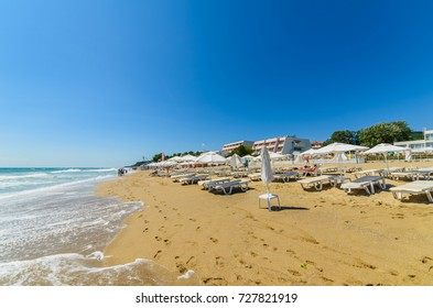 OBZOR, BULGARIA - JUL 14, 2017: City Beach. Sun umbrellas and sun beds on the beach. People relax on the beach. Picture taken during a trip to Bulgaria.
