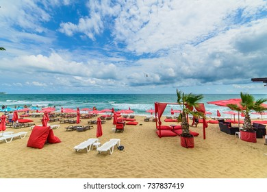 OBZOR, BULGARIA - JUL 16, 2017: City Beach. Sunny umbrellas and sun beds on the beach.