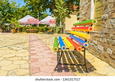 OBZOR, BULGARIA - JUL 22, 2018: Bench of the big colored pencils. Central square. Architecture and streets of the town of Obzor in Bulgaria.