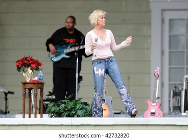 OCALA, FL - DECEMBER 12: Country music star Lorrie Morgan (right) playing live onstage at Silver Springs on December 12, 2009 in Ocala, Florida