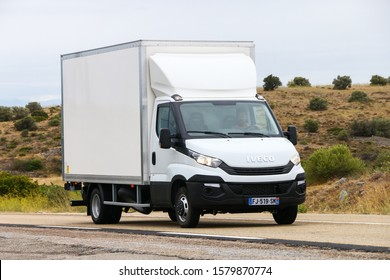 Occitanie, France - September 10, 2019: White cargo van Iveco Daily at the interurban road.